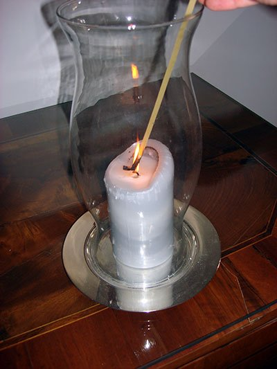 candle lit with long thin fettucini noodle